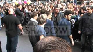 One Direction coming out of their hotel with fans in Paris