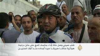 أمة واحدة - صيني يصل إلى مكة المكرمة على متن دراجة هوائية