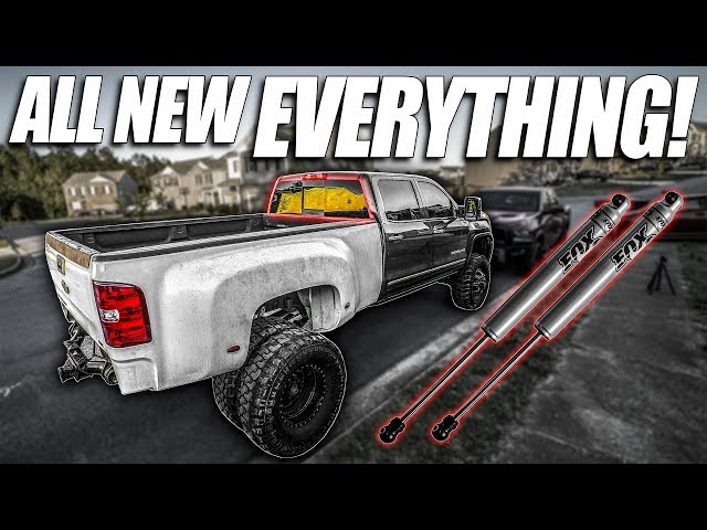THE DUALLY GETS SHOCKS, NEW CARPET, AND WINDOWS!!!