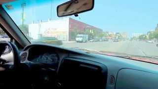 DETROIT - MATTHEW LOFLIN  DAVIS - Driving on Woodward Avenue in Midtown