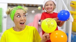 Lev and Mom have fun with balls