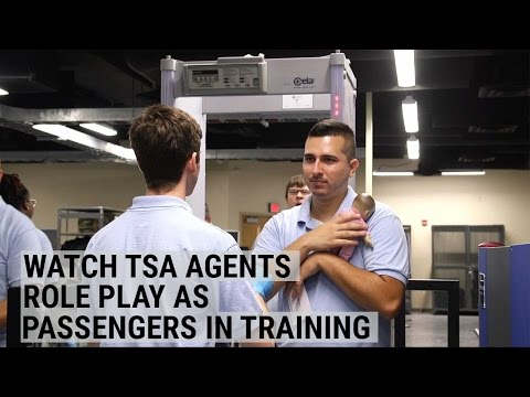 Finally! Watch TSA agents line up and go through security as they role-play passengers in training