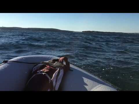 Inflantable boat on Navigator on rough sea