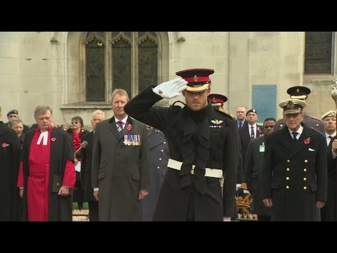 Harry and Philip lay crosses in Garden of Remembrance