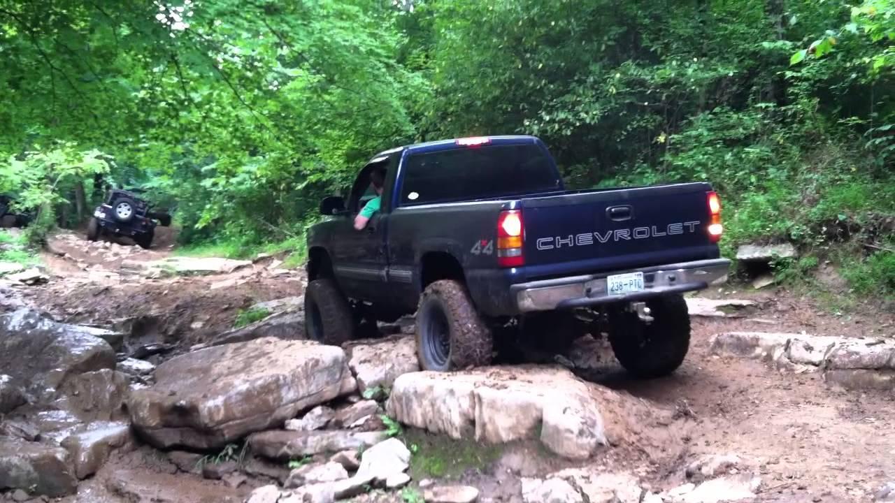 Chevy Rock Crawler : Lifted chevy silverado come close to flipping while rock