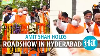 Amit Shah holds roadshow in Hyderabad, dares KCR to admit 'alliance' with AIMIM
