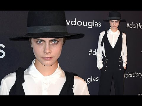 Cara Delevingne turns heads in jumpsuit and wide-brimmed hat in Berlin