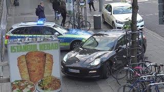 Falsch parkender Porsche blockiert Polizeiwagen auf Alarmfahrt am Bonner Suttner-Platz am 9.5.19