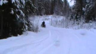 mt. ida forest service road 01.MP4 quading up the hill looking for the deep white stuff
