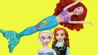 ARIEL shows ELSA & ANNA swimming tricks in the POOL