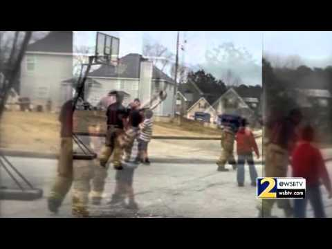 Firefighters join neighborhood kids for game of basketball