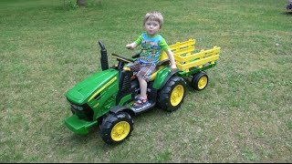 Little Boy Loves John Deere Tractors