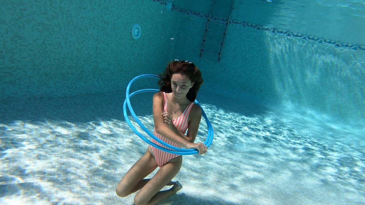 Carla swimming underwater with Hula Hoops