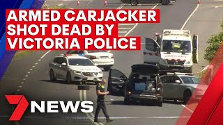 Armed carjacker shot dead by police in a dramatic stand-off east of Melbourne | 7NEWS