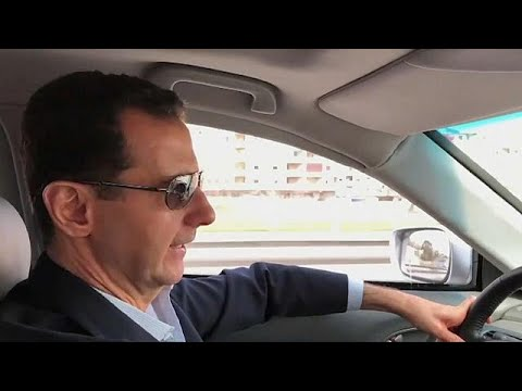 President Bashar al-Assad filmed driving himself to the Syrian civil war's front line