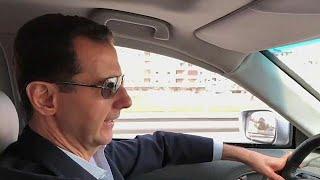 President Bashar al-Assad filmed driving himself to the Syrian civil war\'s front line