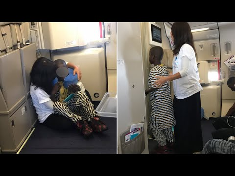 Woman Consoles Crying Child Having A Meltdown During Flight