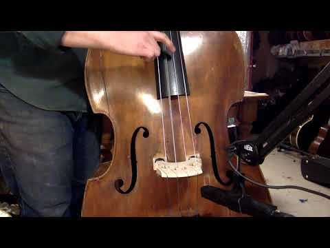 Jake demos a 1920s unmarked carved-top 3/4 double bass