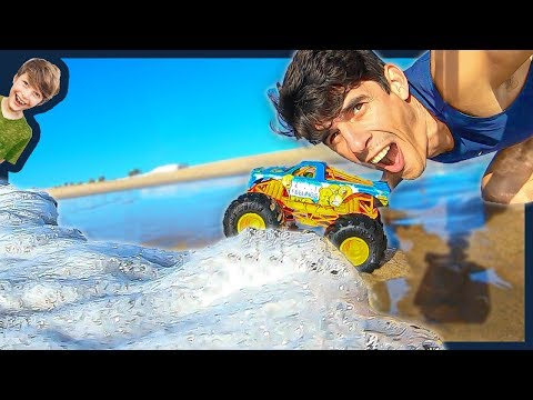 Monster Trucks In The Waves At The Beach!