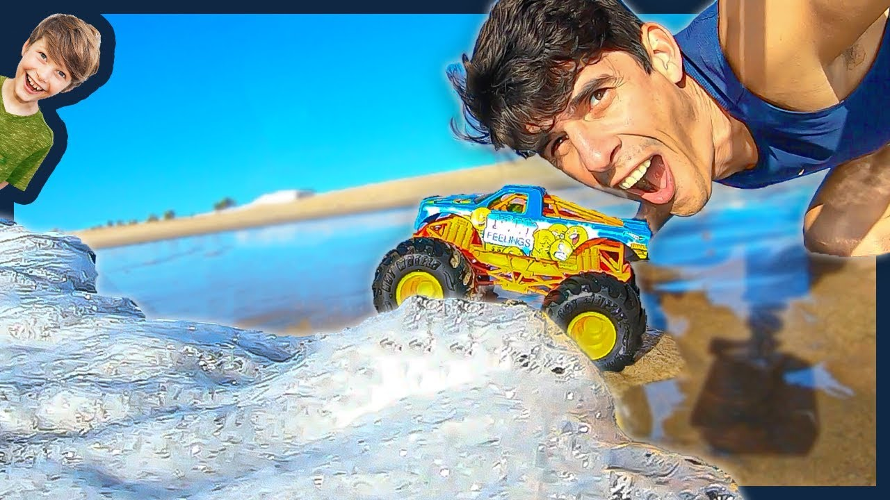 Monster Trucks In The Waves At The Beach Youtube