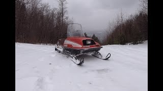 Working on and riding a snowmobile