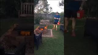Throwing gasoline on a fire pit