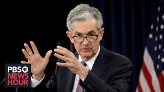 why the fed kept interest rates steady for now despite pressure from trump