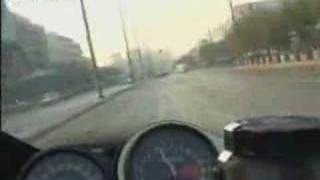 crazy lunatic driving through traffic