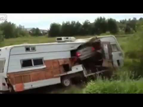 Idiots Jump The Railroad Tracks In A Car And Fly Right Through A RV