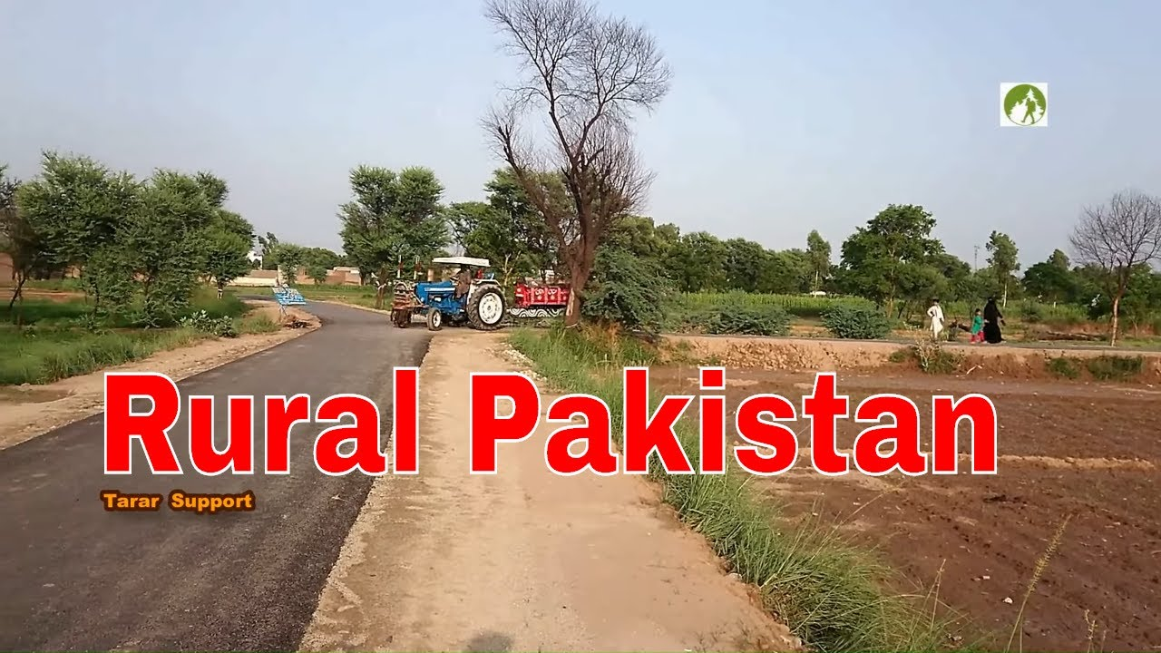 Rural Pakistan Ford Tractor On Village's Road