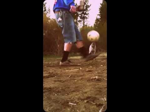 Juggling soccer ball with dog