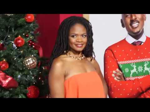 Kimberly Elise  brights in an orange smile.