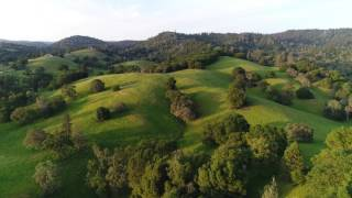 Sunset over some beautiful hills in CA - HD 4K drone video