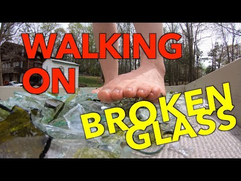Woman Walking on Broken Glass Barefoot - Very Carefully