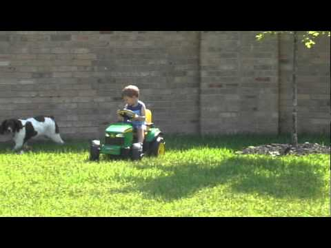 Everett drives Reid's tractor