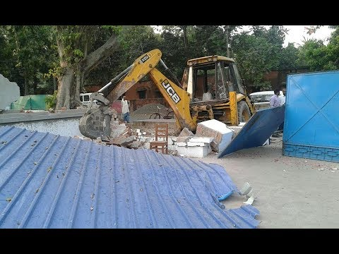 Barrackpore modern school is getting demolished ,students sit down on road for strike