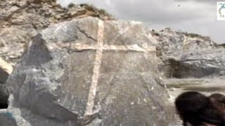 Rock with embedded cross discovered
