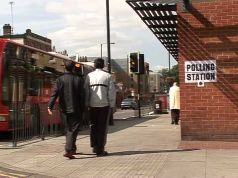Brown battles for survival as Britain votes