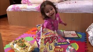 Little Sarah playing with surprise toys and dolls Elsa Frozen