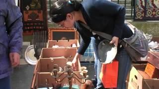 Marisa searches boxes at the Porte de Vanves market