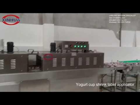 Yogurt cup shrink label applicator