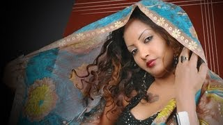 Repeat youtube video *Helen Pawlos*Eritrean New Hot Tigre Song *Beal Meshedel* 2013
