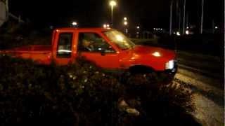 Isuzu TF Pickup driving over the bush