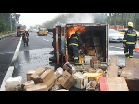 Delivery truck catches fire on expressway in south China