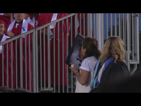 Parents accept diploma on behalf of late teen during meaningful Kerman High School graduation ceremo