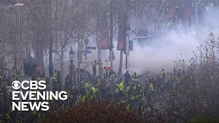 French police fire tear gas at protesters in Paris