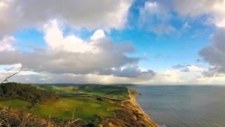Storm and double rainbow time lapse over the sea