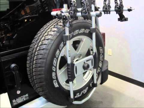 Jeep Wrangler Unlimited Spare Tire Bike Rack Thule SpareMe 963PRO by Rack Outfitters