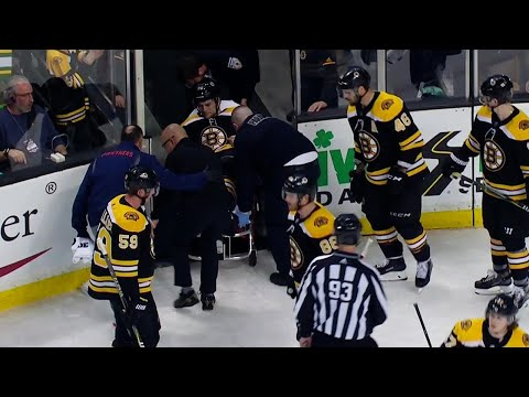 Bruins' Carlo stretchered off after ugly fall near boards