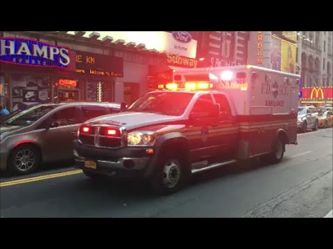 FDNY Ambulance Responding With Lots Of Siren Action Through Midtown Manhattan Traffic On 42nd Street